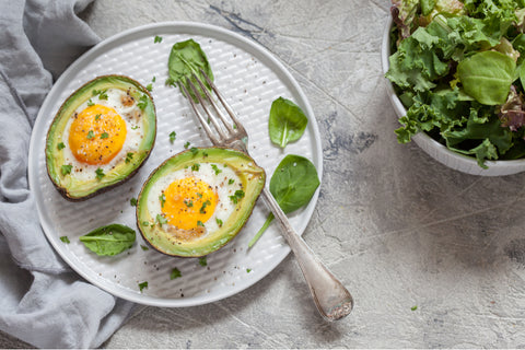 High-fat keto meal of egg and avocado