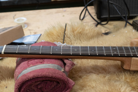 fretboard of a luthier's custom build