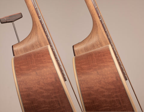 adjustable action on an acoustic guitar in use. Left is higher, right is lower.