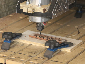 Here I am using the CNC Router to create the individual saddle plates.