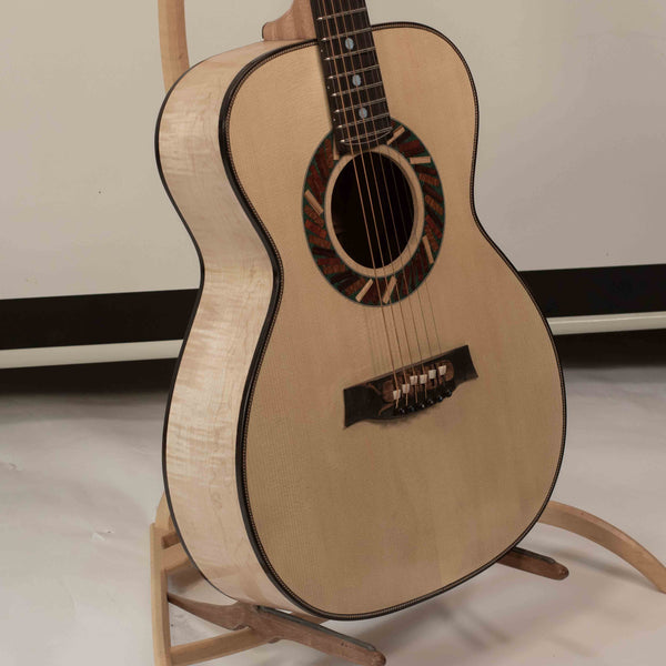 a perfect intonation guitar with an acousitc guitar bridge with guitar compensation