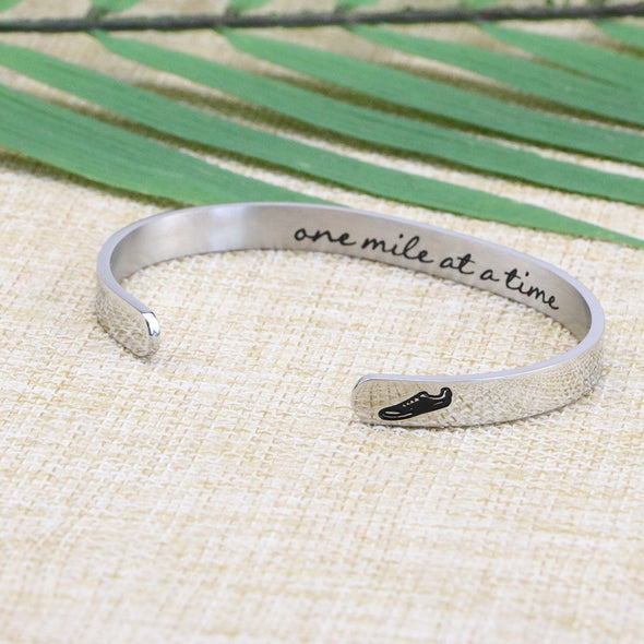 One mile at a time Marathon Jewelry