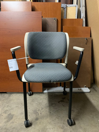 Item #129: Inflex chair with casters