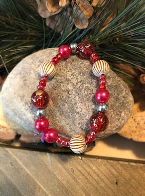 Beautiful multicolored red beaded stretchy bracelet