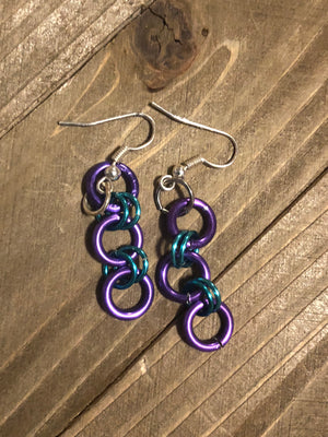 Purple and blue dangling jumping earrings