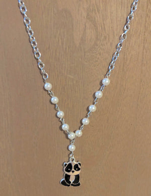 Silver chain necklace with pearl beads and a dangling Panda Bear