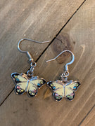 Butterfly outlined in silver, white black wings