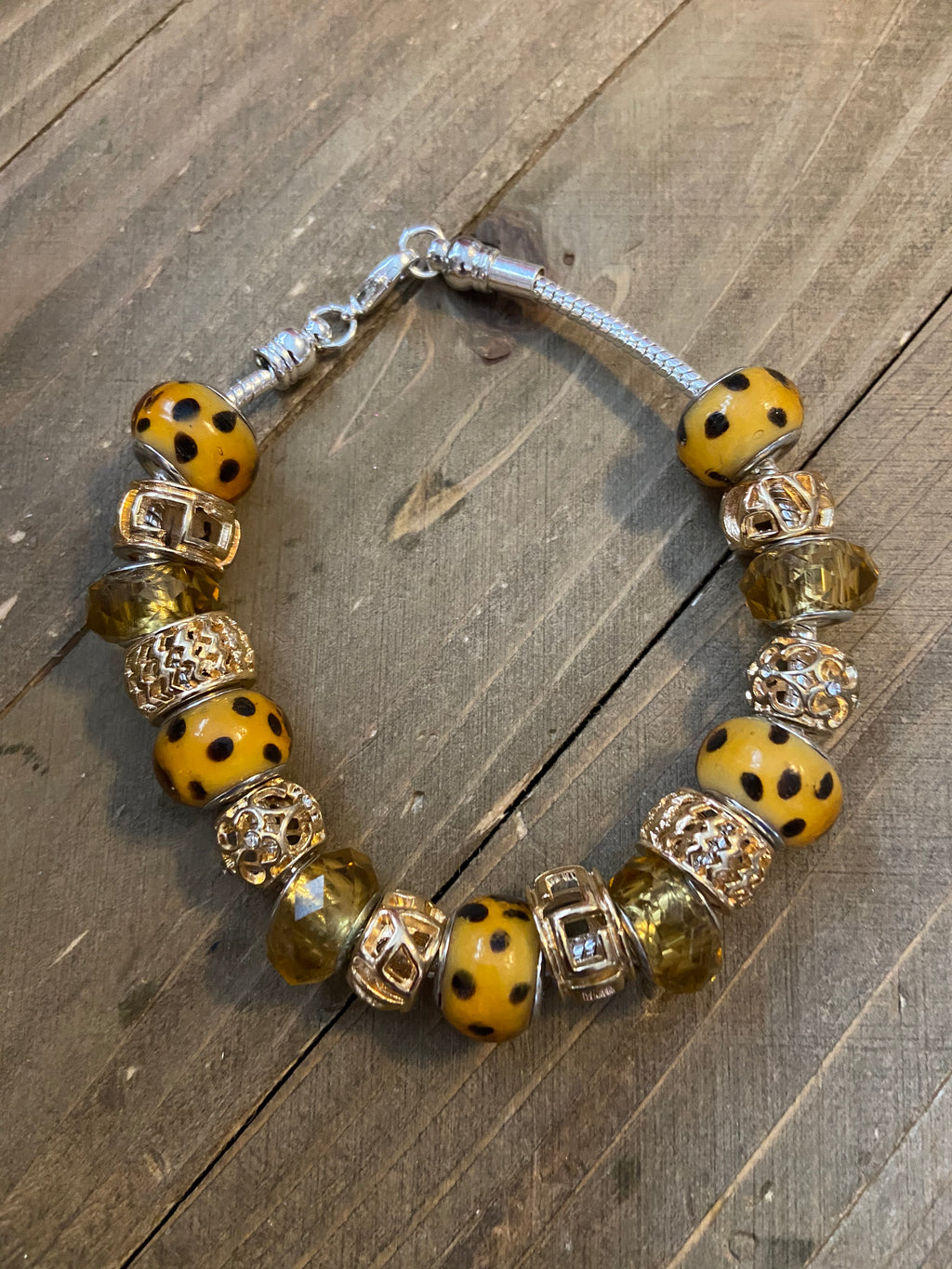 "Yellow and Gold Glass Mix and Mingle beaded 7.5"" silver bracelet"