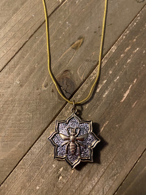 Gold and Silver flower shaped with a Bee Pendant on a Gold chain Necklace