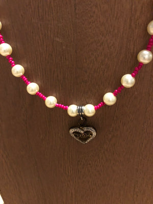 Pretty pink and white beaded necklace with heart pendant