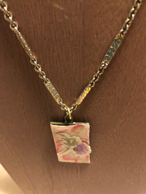 Pretty gold chain necklace with pink and purple flower pendant