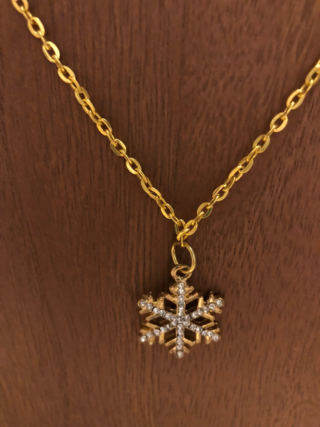 Beautiful gold chain necklace with snowflake pendant