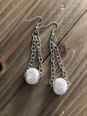 Beautiful Silver chain dangling earrings with a white large hole bead.