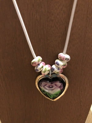 Unique white cord necklace with beautiful white beads with pink flowers and Heart Pendant.