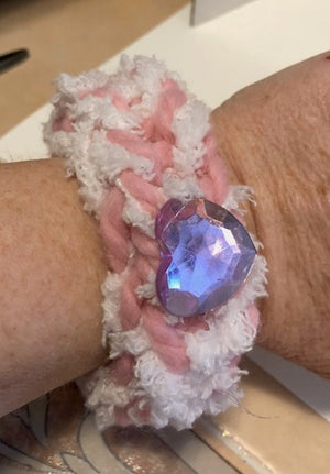 White and Pink Yarn Bracelet with heart shaped Gem in the Center
