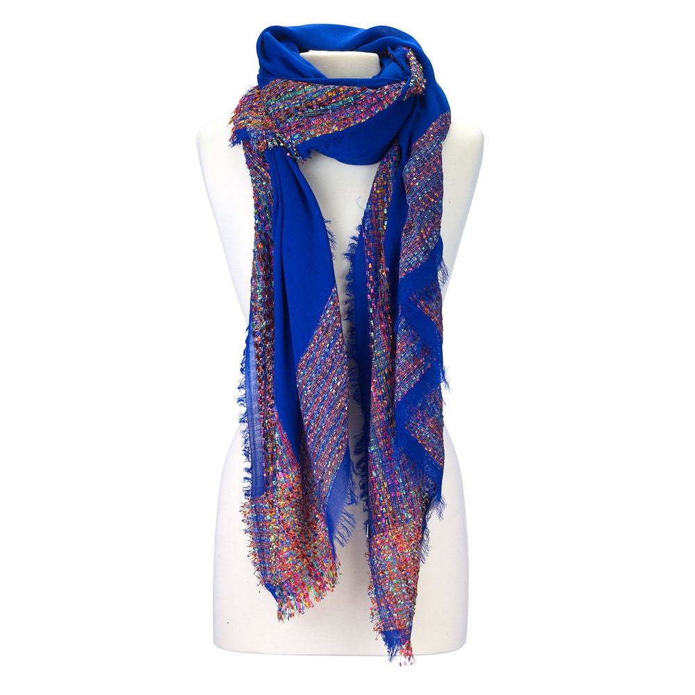Solid scarf with confetti pattern