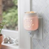 "Inspired by the famous home canning jars, this porcelain fragrance warmer glows when lit with the phrase ""home sweet home."""