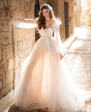 Feather-detailed A-line gown with plunging V-neckline and long sleeves - Amelie Baku Couture