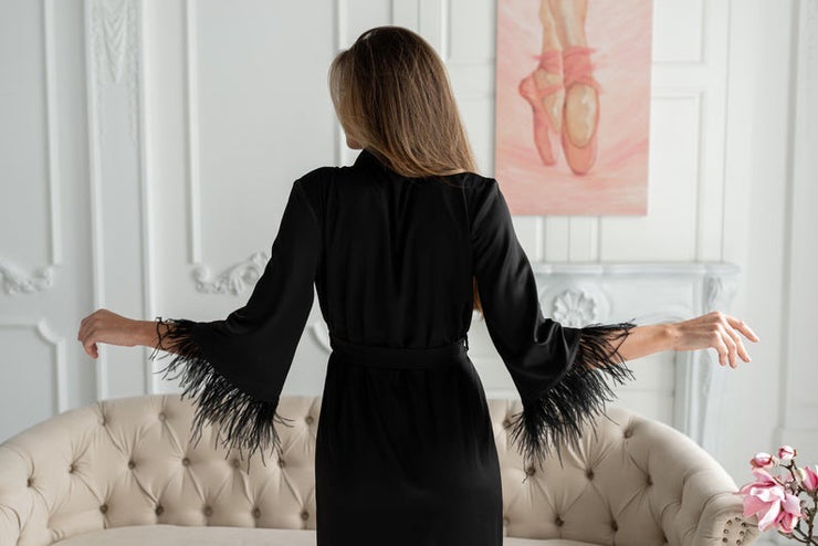 Black Robe with feathers