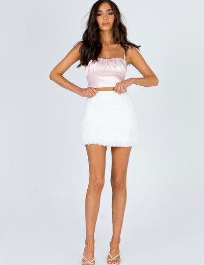 White mini skirt with feathers
