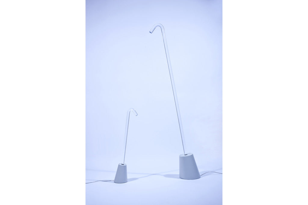 Photograph of the Pole light talbe and floor version by Paul Cocksedge Studio switched off, available to buy at Paul Cocksedge Shop
