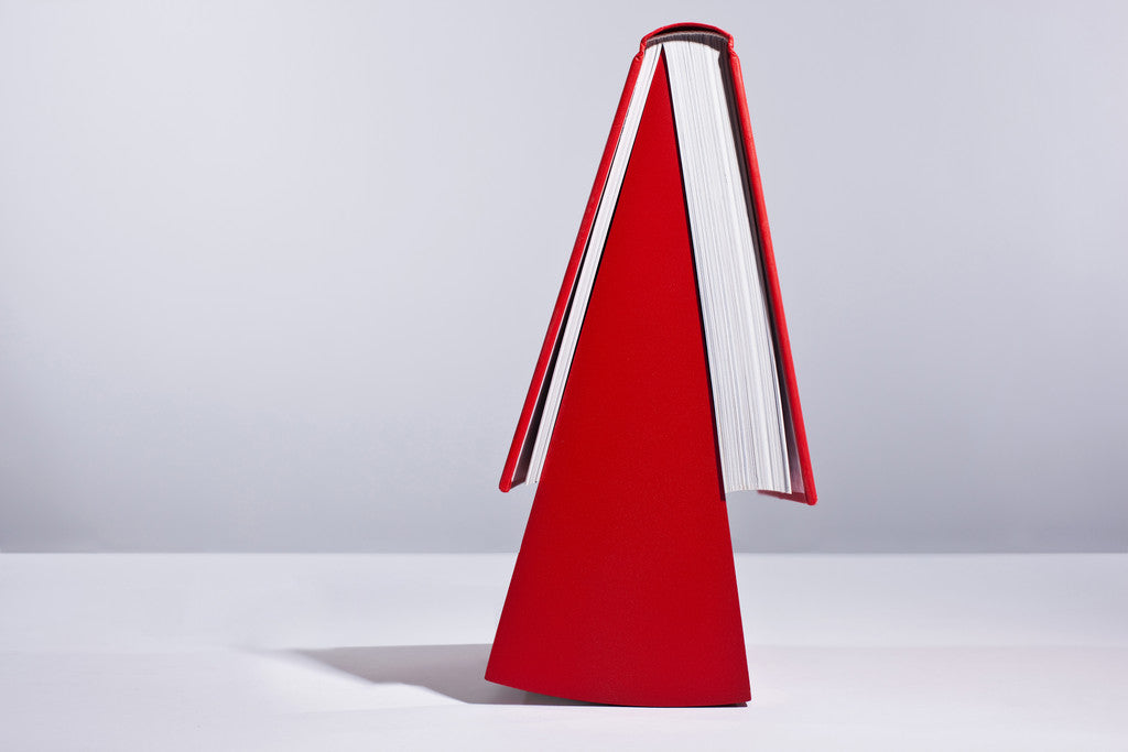 Photograph of the red Bookmark by Paul Cocksedge Studio, available at Paul Cocksedge Shop