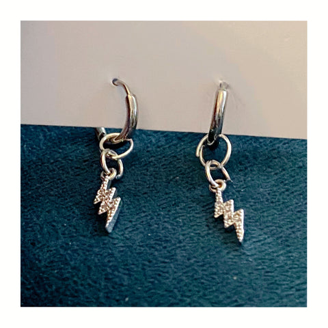 Lightning huggie earrings by Wish