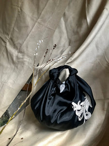 Raven embroidered bag