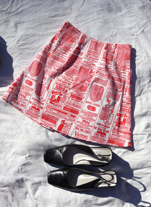 load image into gallery viewer, chelsea skirt - red newspaper
