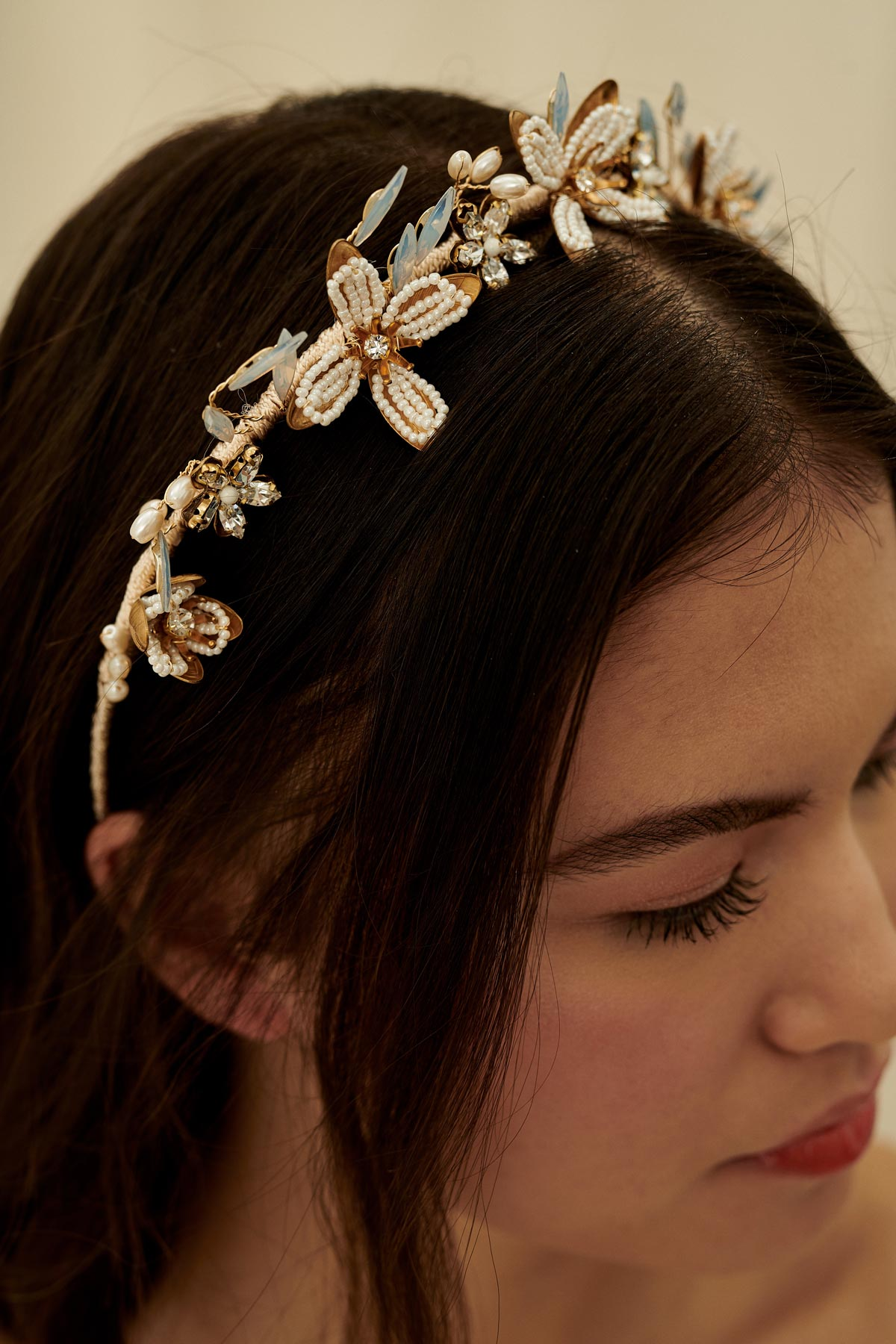 A dreamy boho wedding hair accessory made with intricate brass flowers, glass beads, and opal marquise crystals