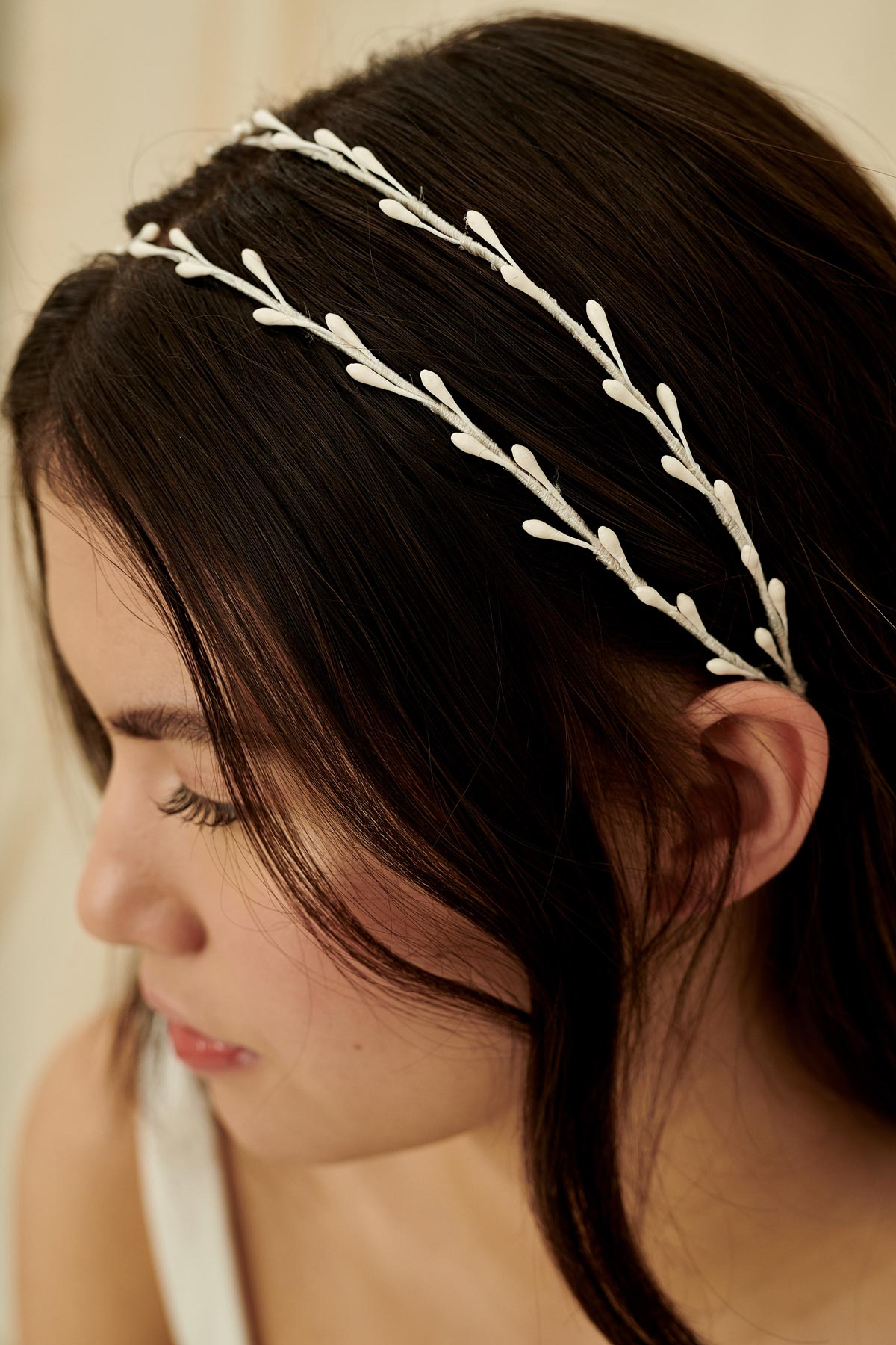 Unique and delicate wedding headband featuring two strands of wax orange blossoms