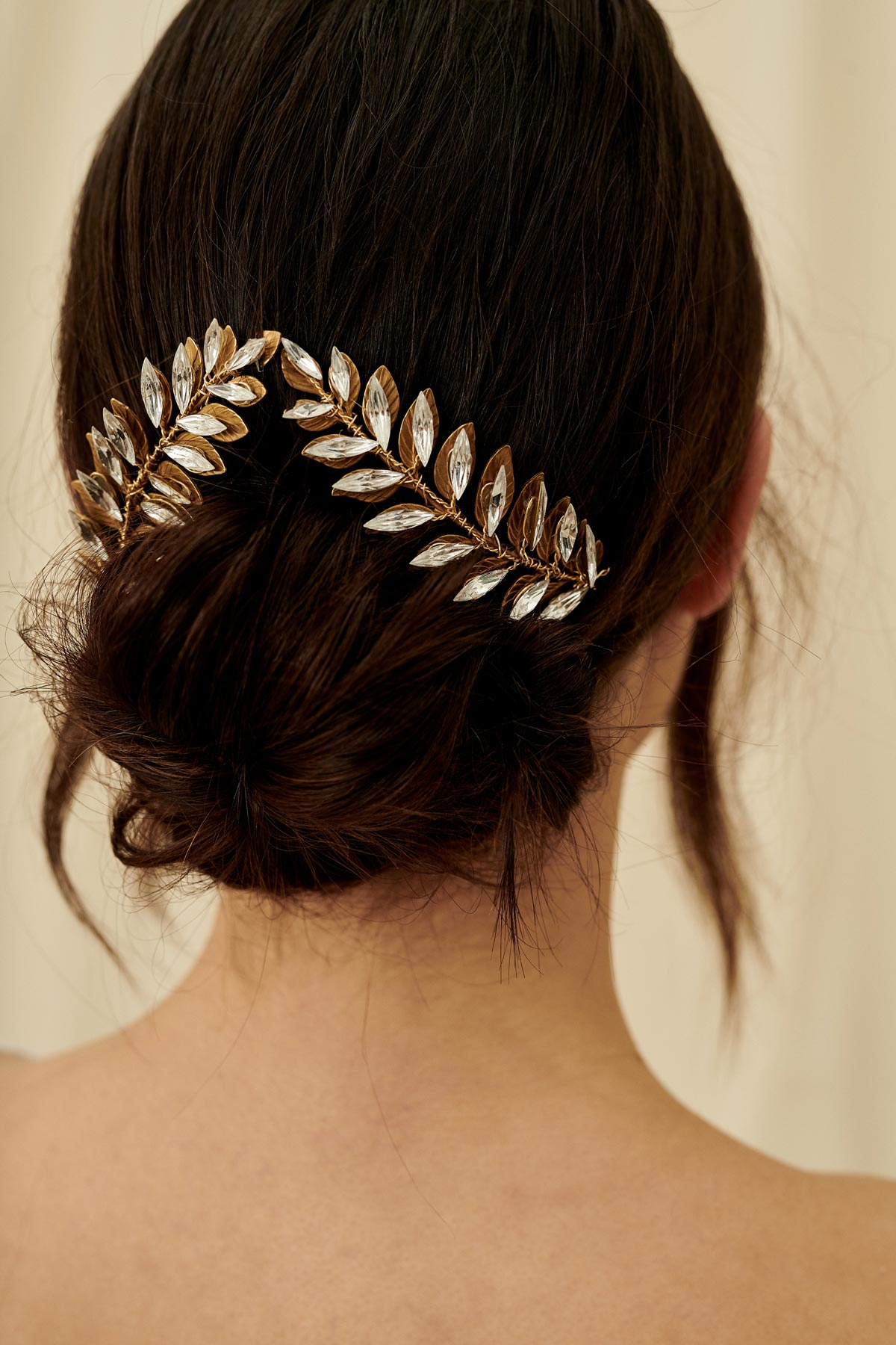 A glittery set of bridal hair pins featuring marquise crystals arranged in a leaflike pattern