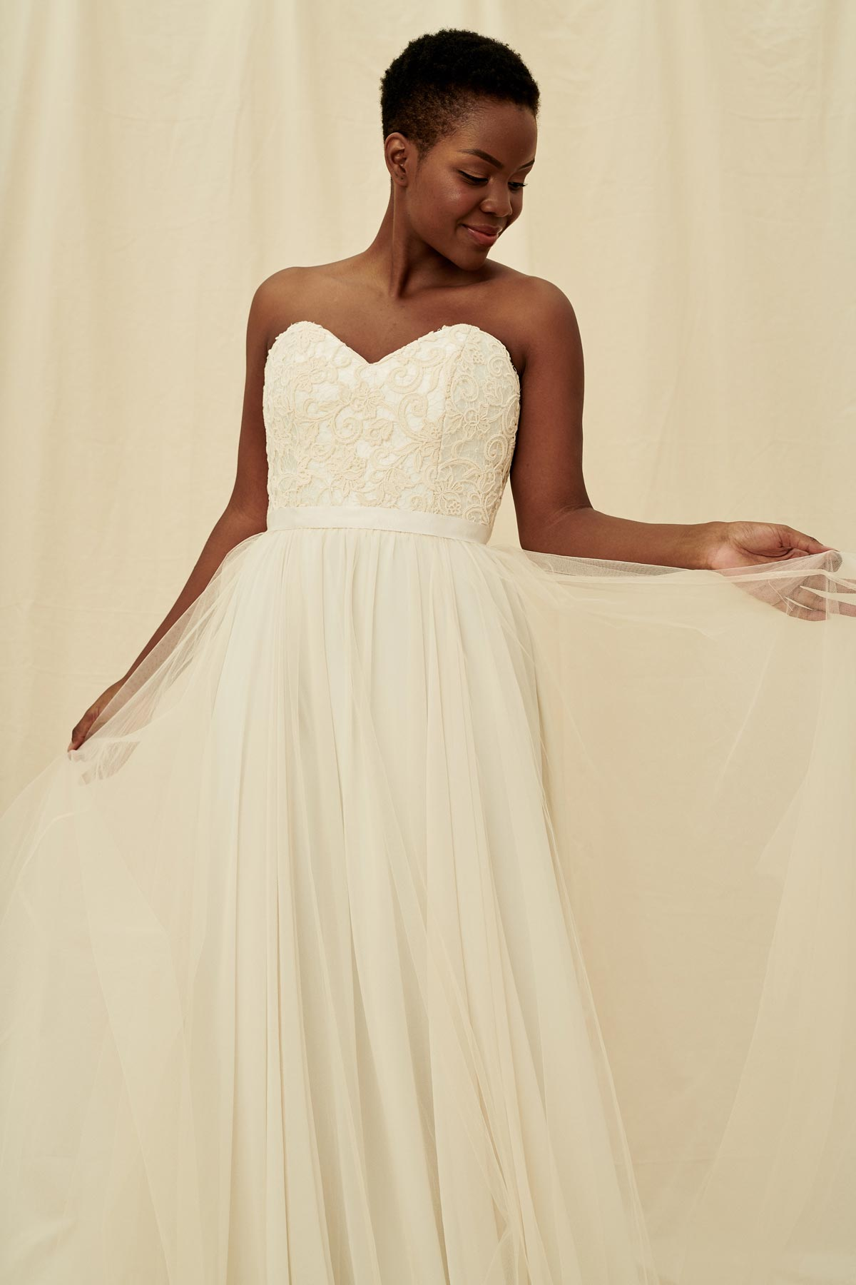 55fe6569f3 A strapless sweetheart gown with beaded lace