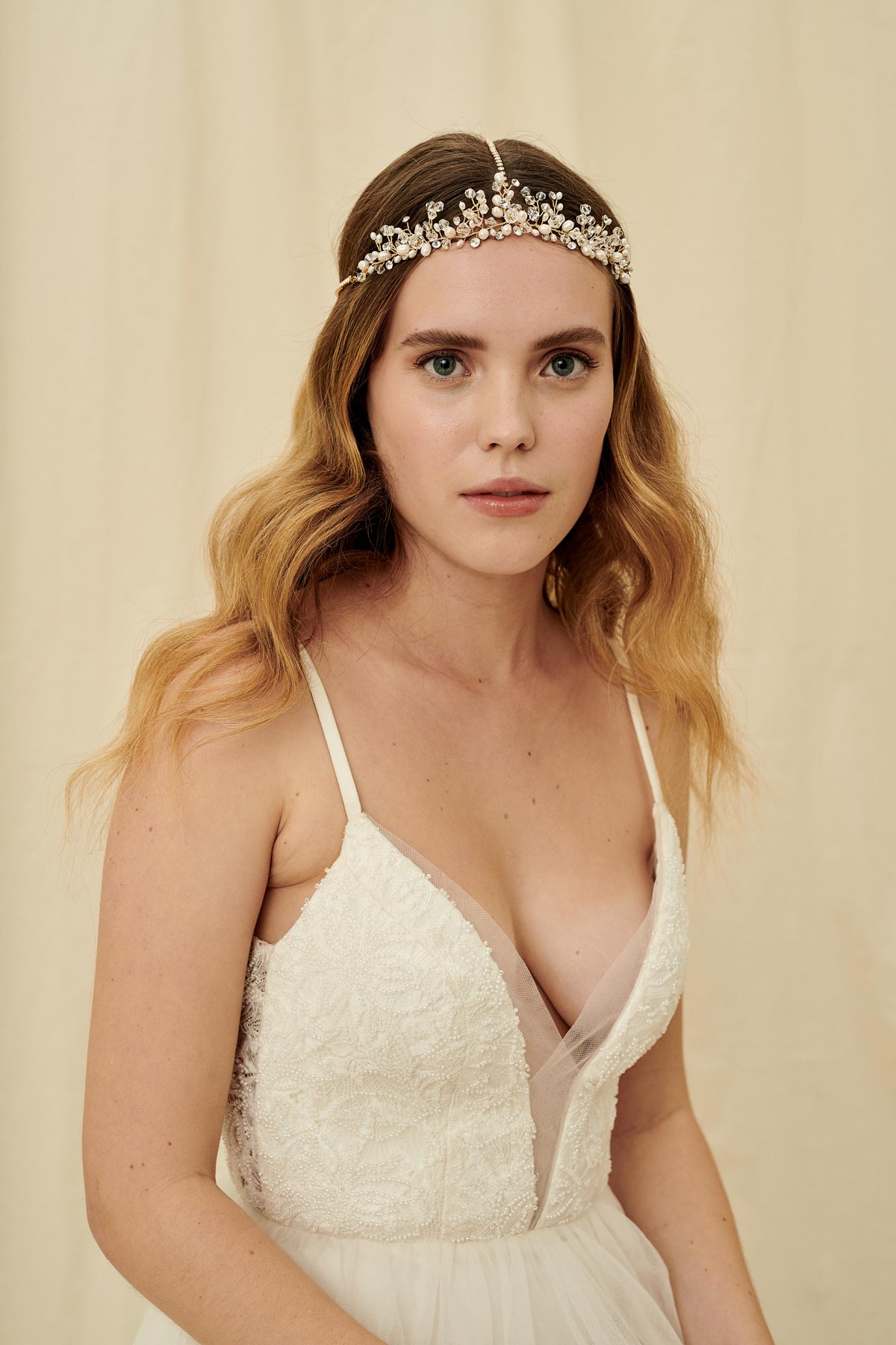 A vintage-inspired three strand bridal headpiece made with pearls and Swarovski crystals