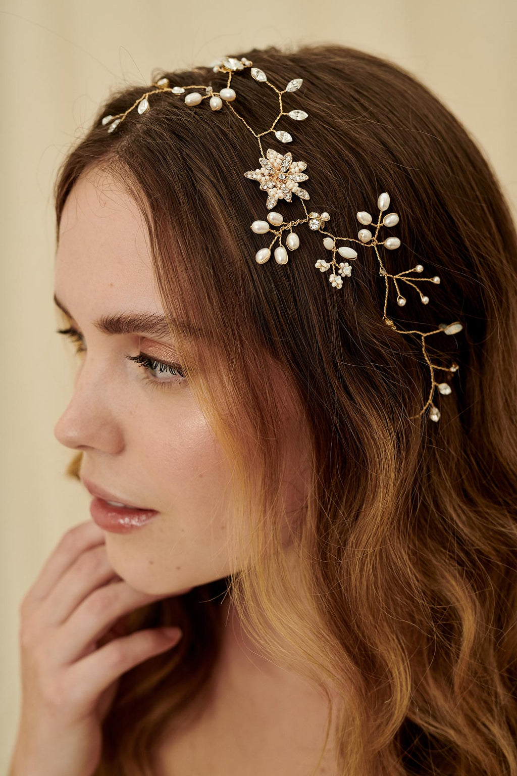 Delicate bridal hair vine with golden wire, freshwater pearls, clear & opal Swarovski crystals, cream beading and a single small brass flower