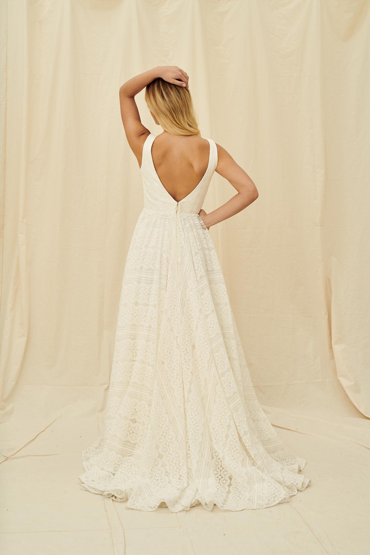 A full lace dress with a scoop neck and a low back
