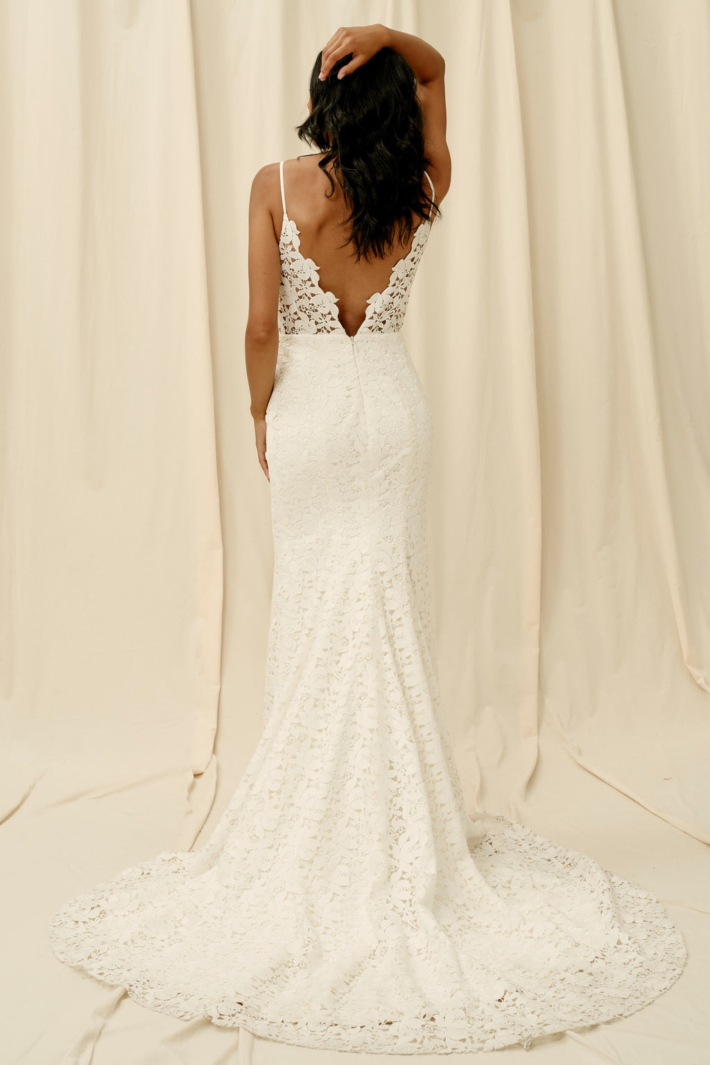 Open back wedding dress with mermaid skirt and long train