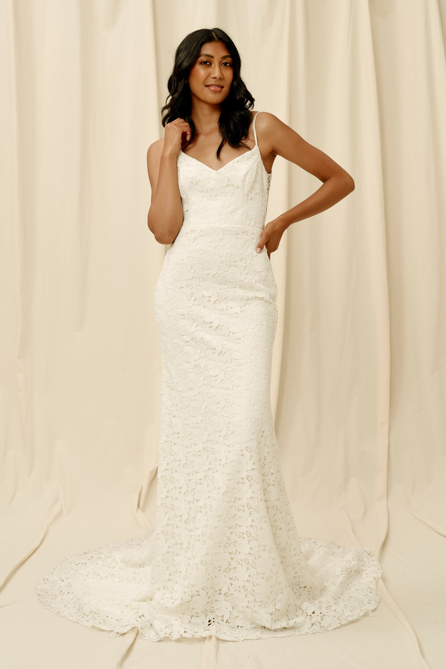 Fitted lace wedding dress with spaghetti straps