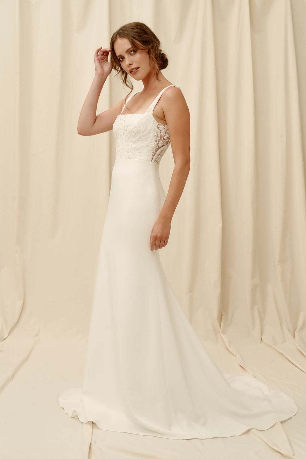 Fitted crepe wedding dress with low back and square neck