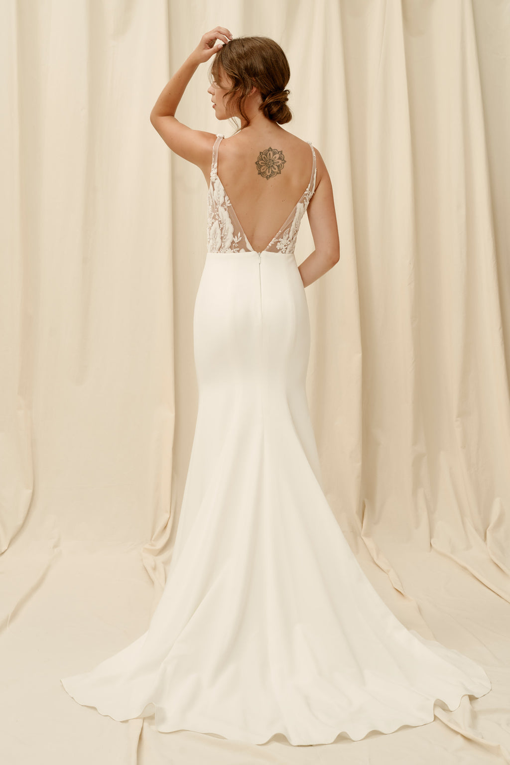 Backless mermaid wedding dress with crepe skirt and lace top