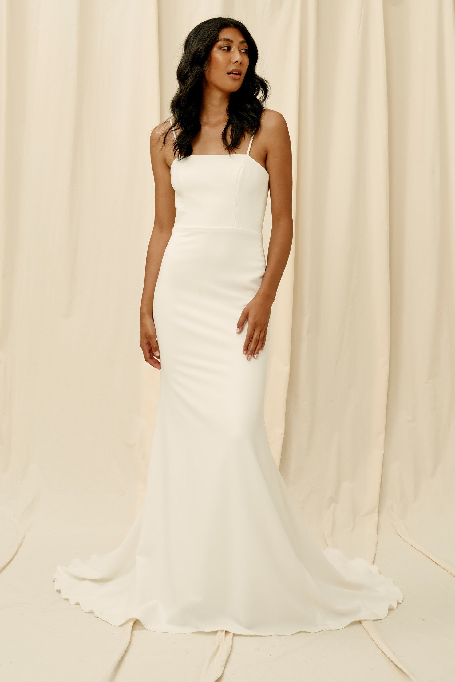 Fitted crepe wedding dress with spaghetti straps