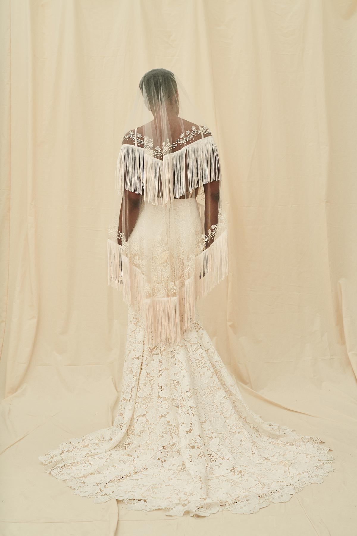 Boho bridal veil made with tulle, flower embroidery, and a long fringe trim
