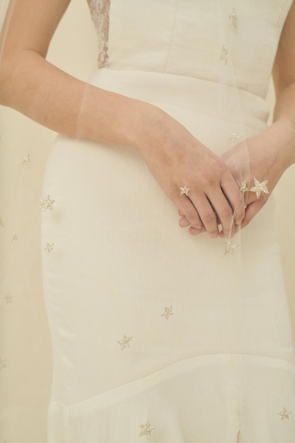 A delicate bridal veil embroidered with tiny beaded silver stars
