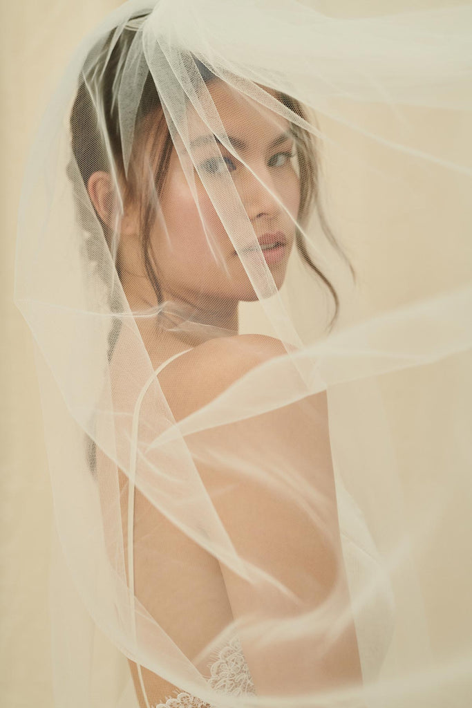 A simple, ethereal extra long bridal veil in a soft tulle