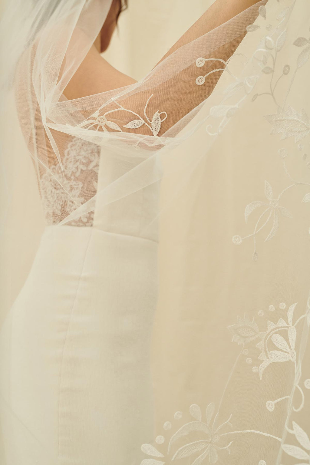 A delicate bridal veil with floral embroidery