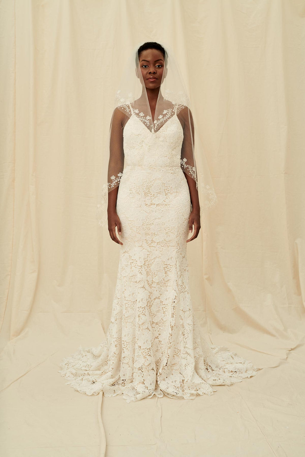 A classic veil with a short blusher and floral embroidery and no trim