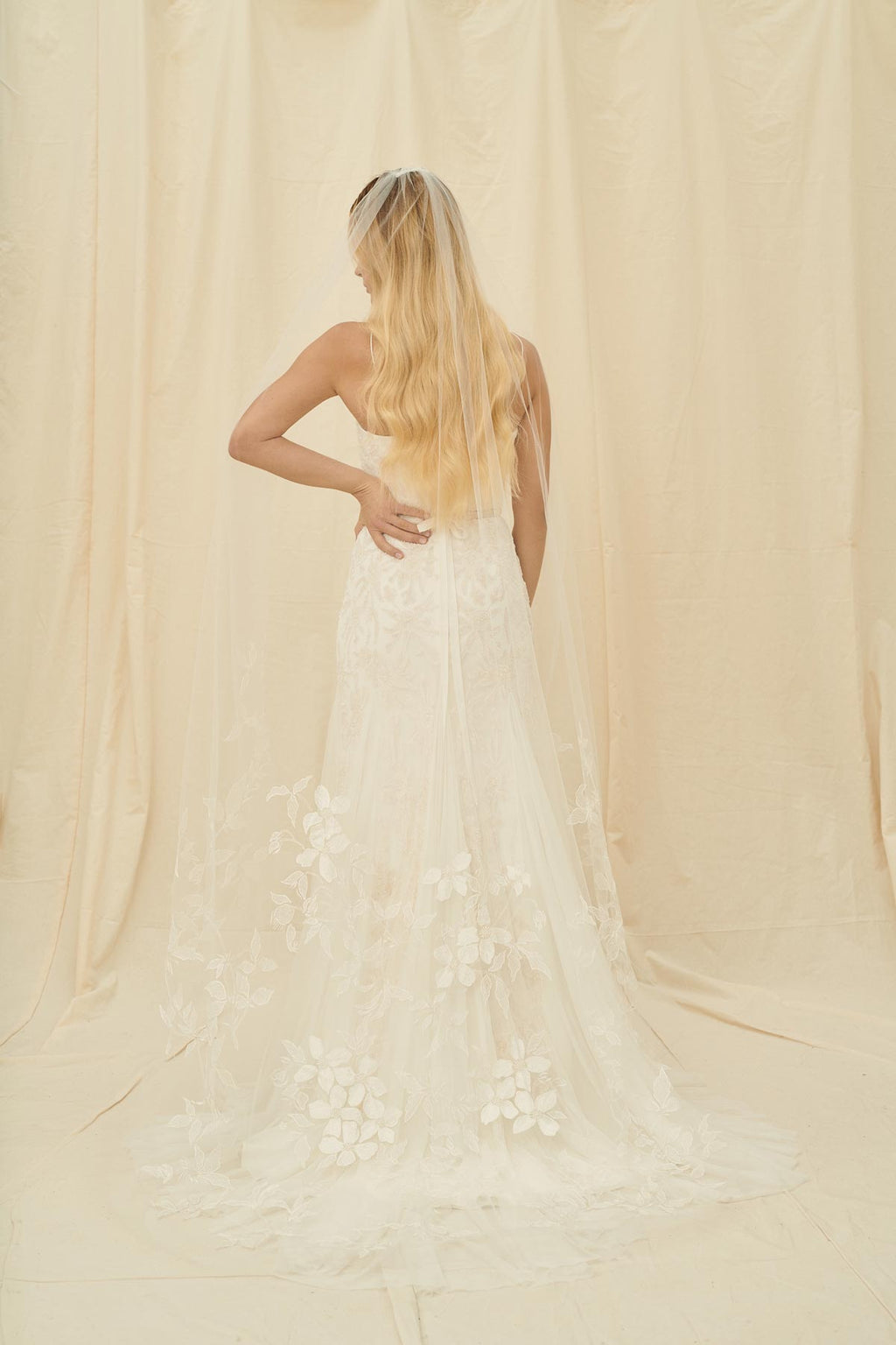 A simple bridal veil with floral embroidery on the bottom half of the soft tulle
