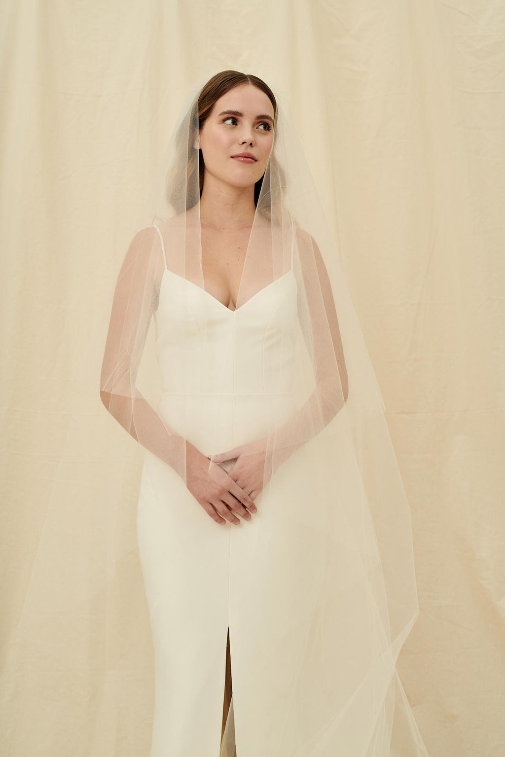 A simple veil with an extra long bottom layer and a front blusher