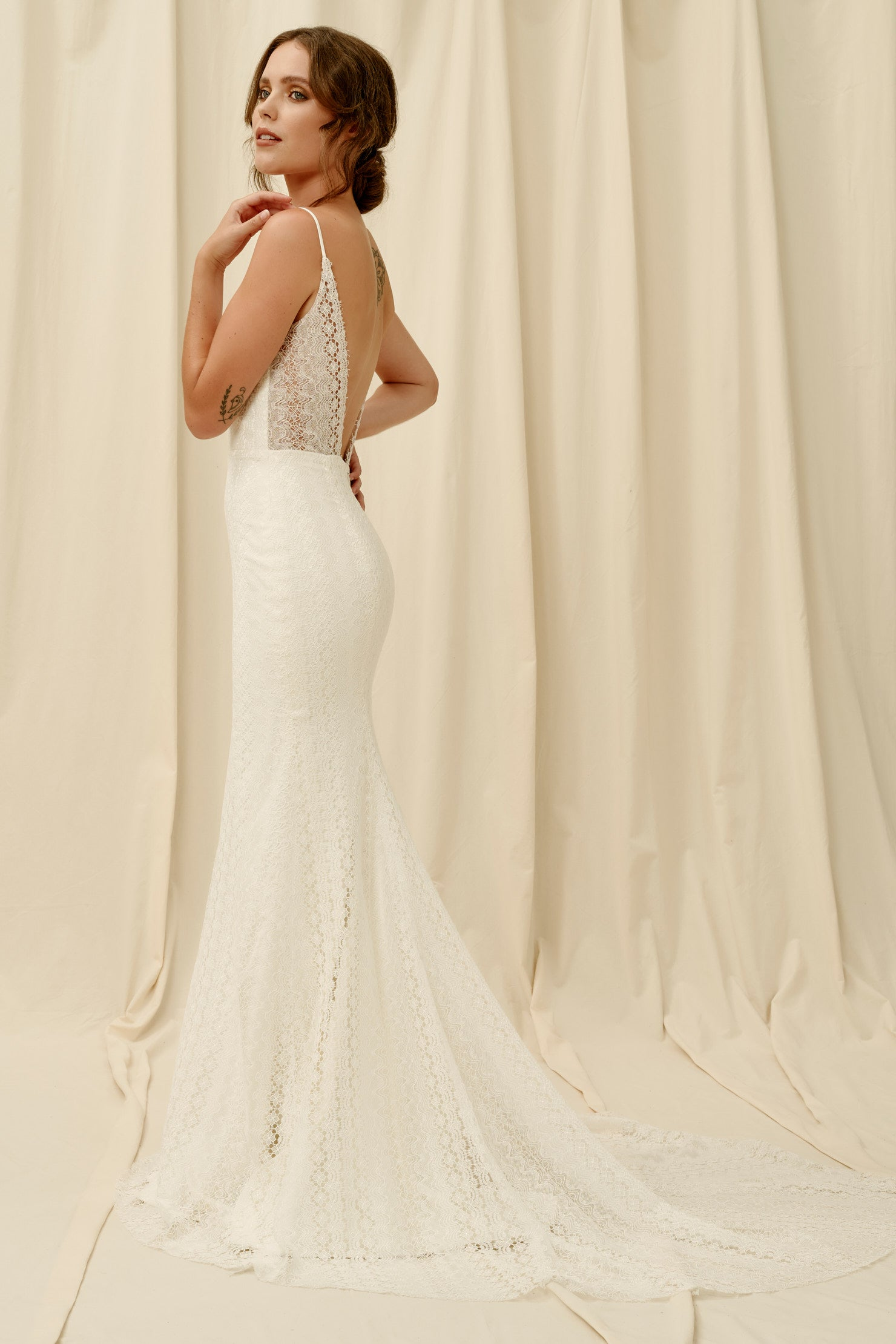 Backless mermaid wedding dress with modern lace