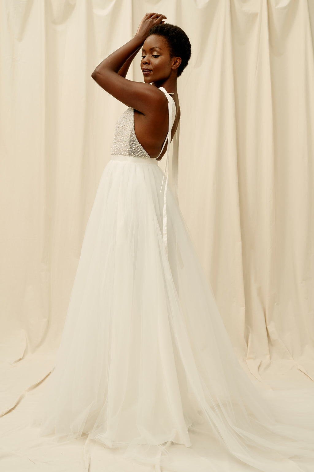 Backless wedding dress with a soft tulle skirt and shoulder tie straps
